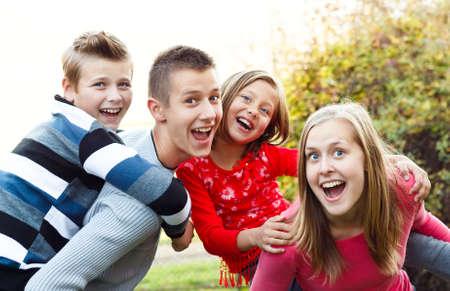 Beautiful babysitter having fun with the children. Standard-Bild