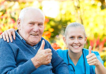 Happy elderly patient with helpful kind doctor. photo