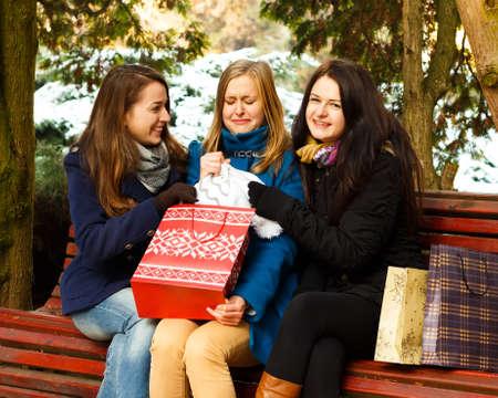 selfish: Selfish woman grabbing her present. Stock Photo