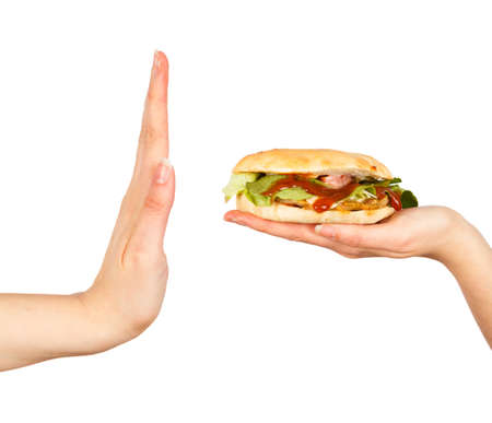 Female hand rejecting the offered unhealthy junk food