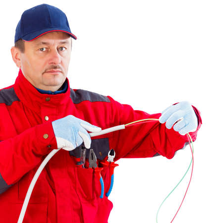 plugging: Friendly electrician plugging cable in flexible tube. Stock Photo