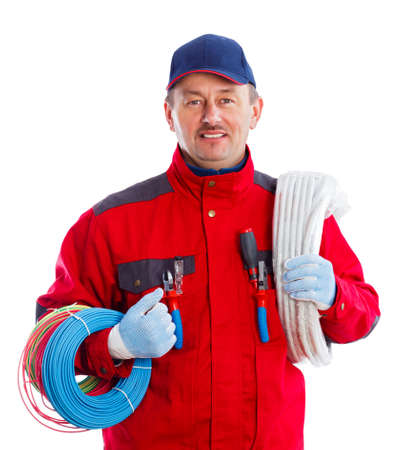 Reliable electrician with colorful wire bundles and flexible tube. photo