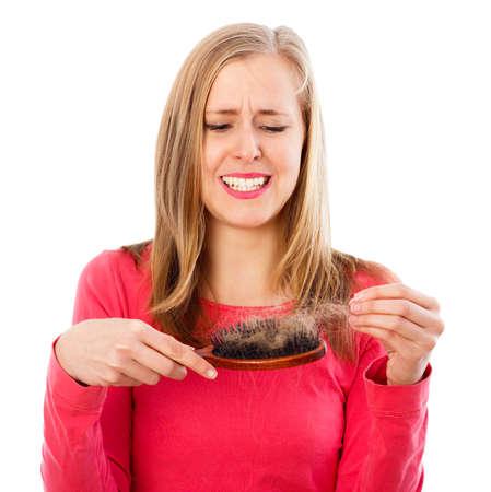 Woman being stressed of huge hair loss - seasonal alopecia.
