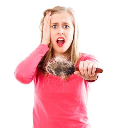 Woman in panic of her hair loss disease.