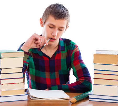 essay: Creative student writing his essay for school. Stock Photo