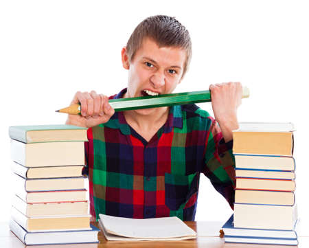 Nervous student biting his pencil in his anger.