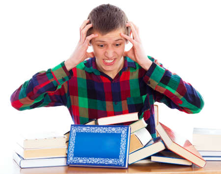 essay: Too much to learn - student lost with his studies. Stock Photo