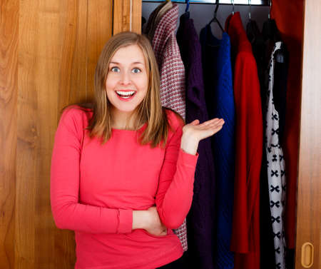 Excited young woman in front of her new closet  photo