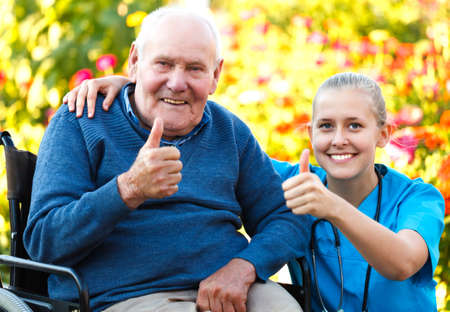 male's thumb: Great mood at the nursing home, happy patient with doctor.