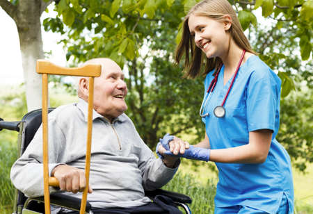 contented: Contented senior patient with kind doctor at the nursing home. Stock Photo
