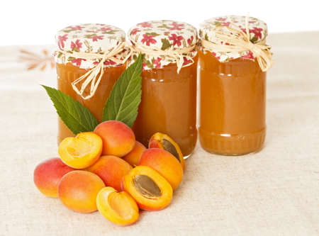 Appetizing homemade peach jams and tasty apricots.