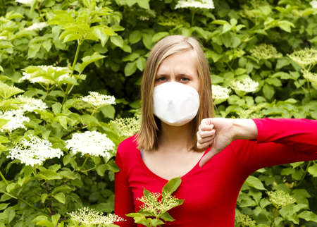 Woman being unwell from allergy to flower pollen.