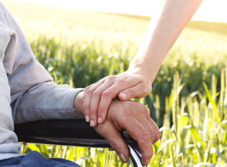 caring for: Caring for the elderly people in wheelchair.