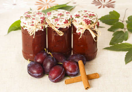 Tasty Plum Jams with Flower Patterned Covers.