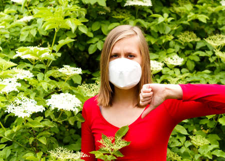 sensible: Woman being unwell from allergy to flower pollen.