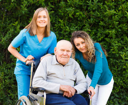 Grandfather together with granddaughter and nurse at the nursing home. photo