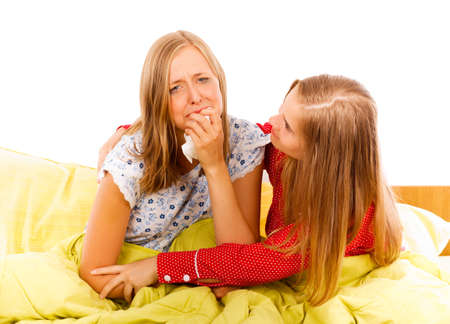 hangup: Kind woman consoling her crying upset girlfriend.