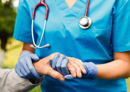 nurse gloves: Professional care for elderly at nursing homes.
