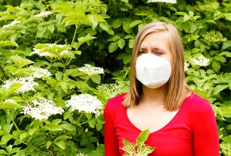 sensible: Woman allergic to elder pollen, sneezing from it.