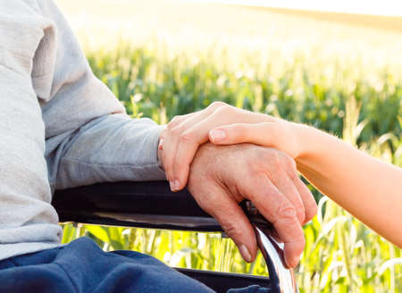 caring hands: Supporting hand for grandfather with Alzheimers disease.