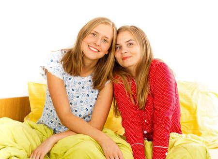 pajama party: Pretty girlfriends having fun on pyjama party. Stock Photo