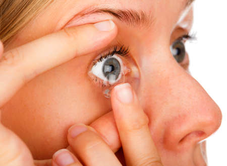 nearsighted: Blue eyed woman applying easily contact lenses.