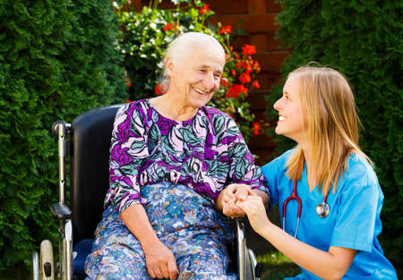 homecare: Supporting hand from kind doctor for the elderly woman.