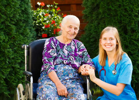 parkinsons: Happy patient and doctor at the twilight home.