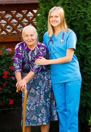 garden staff: Elderly patient and doctor on a walk in the hospital garden.