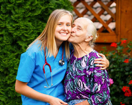 Kind young doctor being admired and loved by elderly patient.