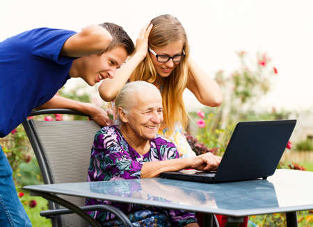 Funny grandmother making a huge mess on the computer.