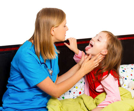 Professional medical examination  - doctor looking at young patients painful throat. photo