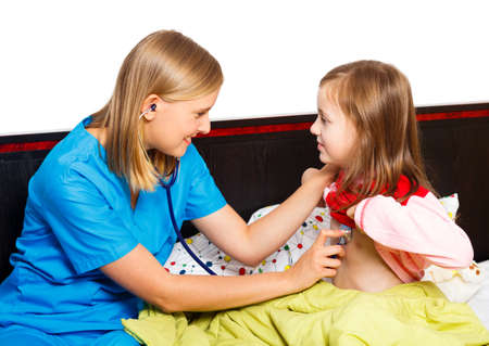 Pediatrician examining with stethoscope  her little patient.