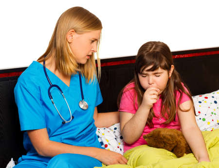 Doctor examining her little patient with severe coughing.