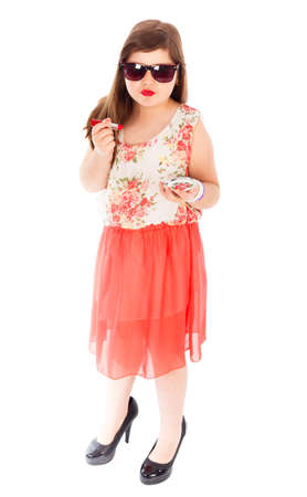 girl in red dress: Poser little girl being trendy, wearing sunglasses and lipstick. Stock Photo