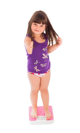 weight gain: Funny little child showing thumbs up for healthy lifestyle.