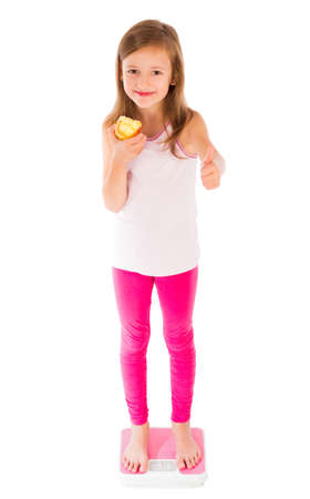 conscious: Healthy, fit young little lady showing thumbs up for conscious lifestyle.