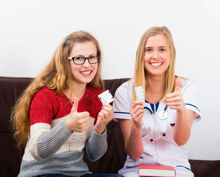 contraception: Conscious teenager at the gynecology, learning contraception. Stock Photo