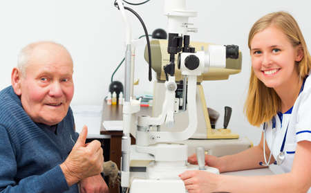 Elderly patient being satisfied with the eye doctor