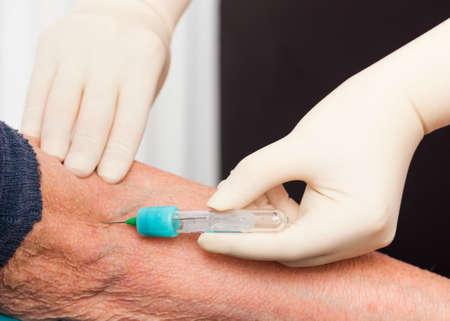 ambulatory: Nurse taking blood sample for monitorizing blood components levels.
