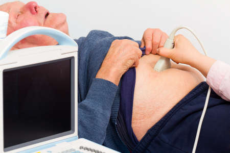 examined: Elderly patient with severe pain being examined on the ultrasound.
