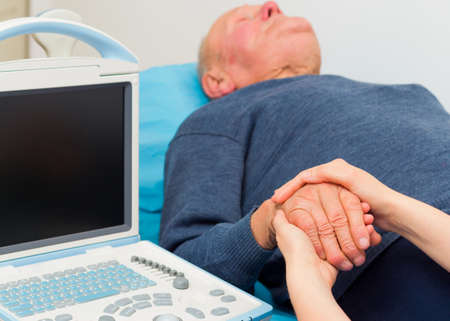 medical attendance: Support for elderly  - getting bad results after ultrasound examination. Stock Photo