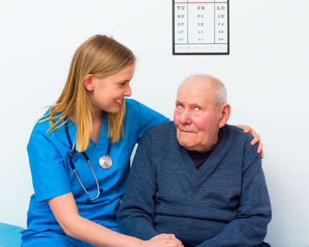 medical attendance: Geriatric doctor taking care of elderly man with dementia.
