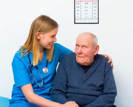 geriatric: Geriatric doctor taking care of elderly man with dementia.
