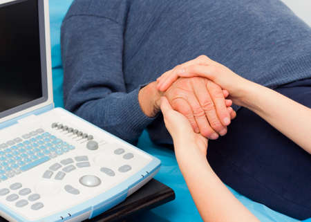 supportive: Supportive hands for elderly diagnosed with serious disease.