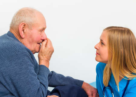 pharyngitis: Elderly man with influenza symptoms at the doctor for a medical check-up.