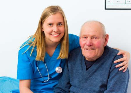 Geriatric doctor taking care of elderly disabled man.