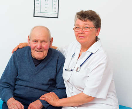 medical attendance: Middle-aged doctor with elderly patient at the nursing home.