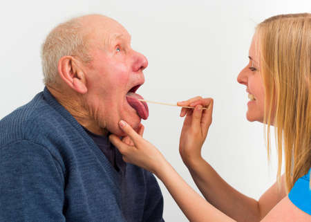 pharyngitis: Elderly man with pharyngitis at the hospital, for medical exam. Stock Photo