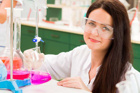 titration: Pharmaceutical researcher making investment on medication poison. Stock Photo
